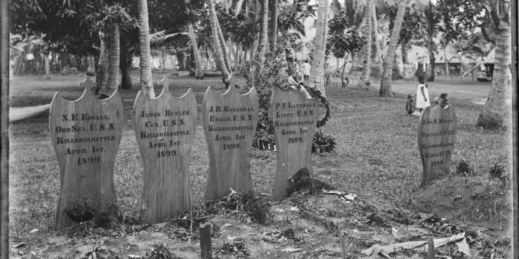 The graves of the Americans on Samoa, an image taken shortly after their burial in 1899. James's headstone is second from left (Photography by Kerry and Co. Tyrrell Collection, Museum of Applied Arts and Sciences)