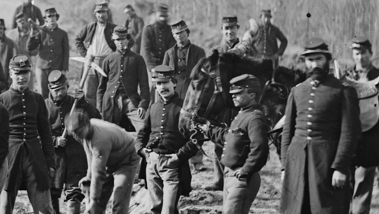 Larkin's Company A, 15th New York Engineers building a corduroy road, purportedly during the Peninsula Campaign of 1862. It's possible that the tall officer at right is Felix Larkin himself. (Library of Congress)